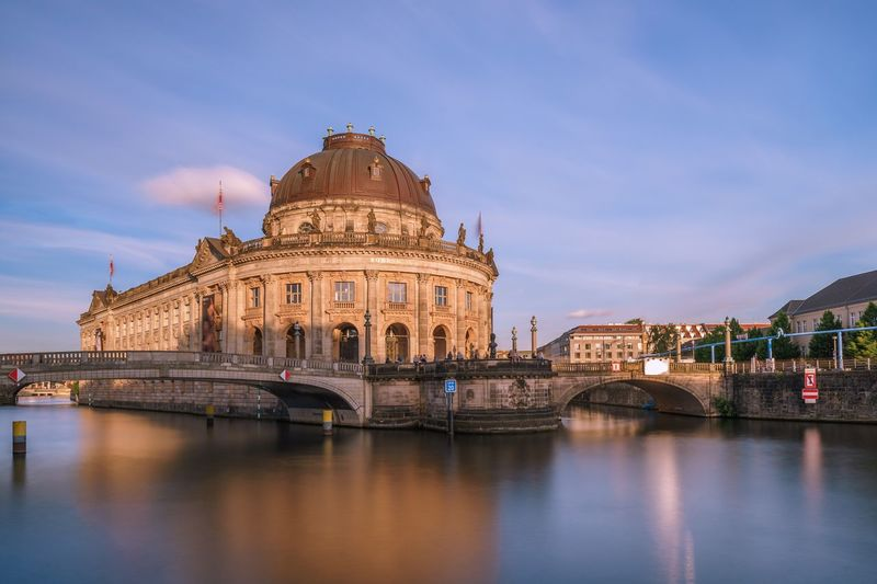 Bode Museum in Berlin, Germany. Berlin Germany Museum Bode Museum Architecture Built Structure Dome Sky Building Exterior Waterfront Reflection History Cloud - Sky Outdoors Travel Destinations Water Blue No People Day Illuminated City Politics And Government