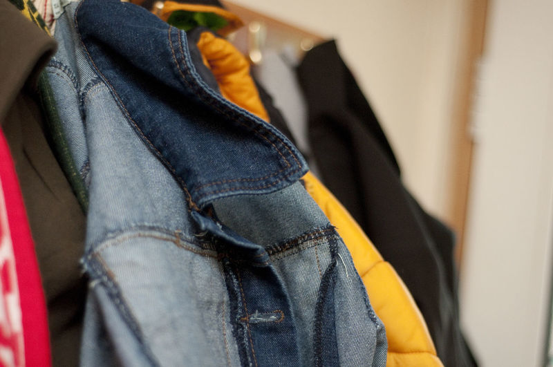 Close-Up Of Clothes Hanging In Closet