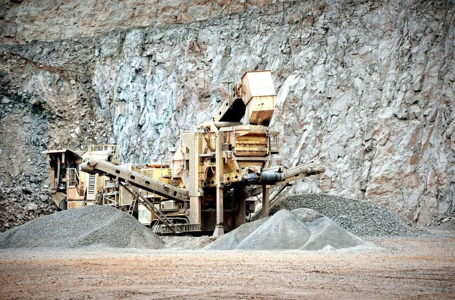portable stonecrusher in an open pit mine Construction Steinbrecher Stone Crusher Open Pit Mine Mine Mining Bergbau Pit Quarry Steinbruch Rock Formation Rocks Excuvator