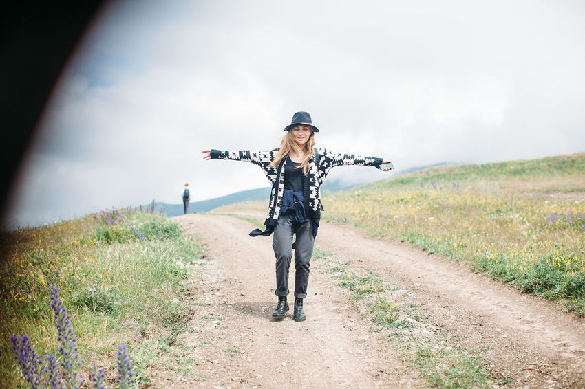 Arms Spread Cloud - Sky Day Female Girl Grass Happiness Happy Hat Hike Hiker Hiking Journey Landscape Lifestyles Nature Nature Outdoor Outdoors Path Portrait Road Sky The Way Forward