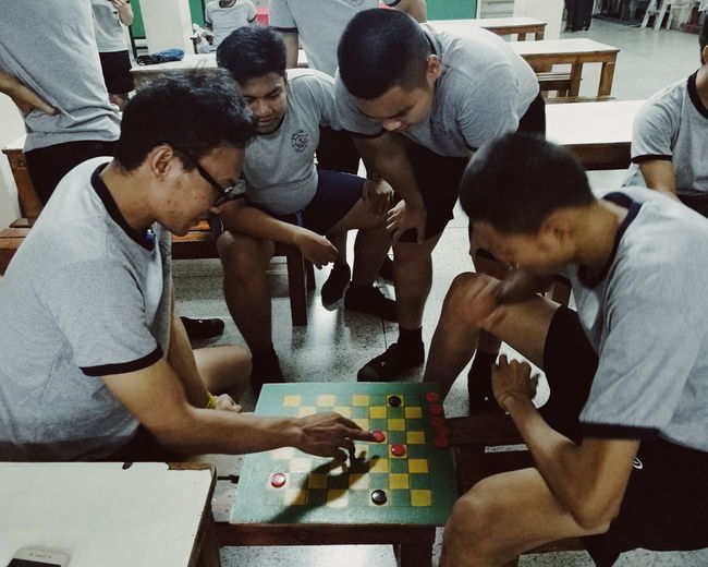 playing games Playing People Indoors  Lifestyles Teamwork Technology Wireless Technology Men Sitting Working Standing Coworker Group Of People Togetherness