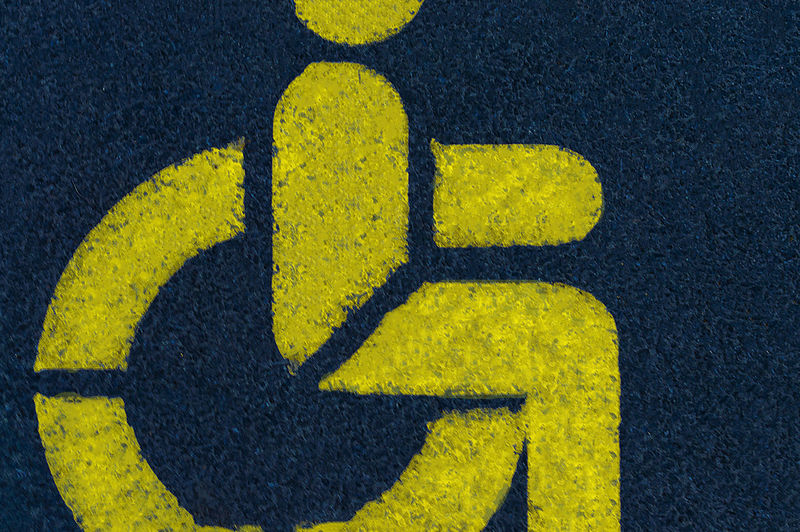High angle view of disabled access sign on road in city