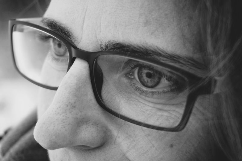 Close-up of woman looking away while wearing eyeglasses