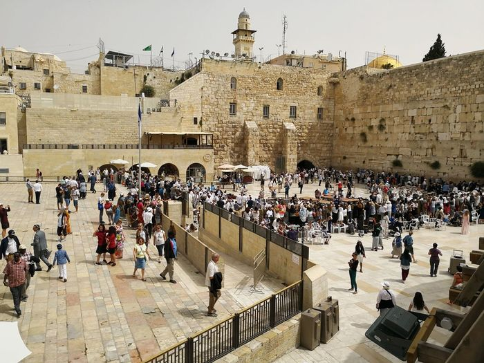 The western wall in Jerusalem Israel Middle East Western Wall Western Wall Of Jerusalem Kotel Israel Praying Worship Place Of Worship Judaism Tradition Judaism Bar Mitzvah Tourists Tourism City King - Royal Person Ancient Civilization Ancient Place Of Worship History Old Ruin Architectural Column Architecture Sky Monument Civilization Pilgrimage Visiting Worshipper Monastery Faith