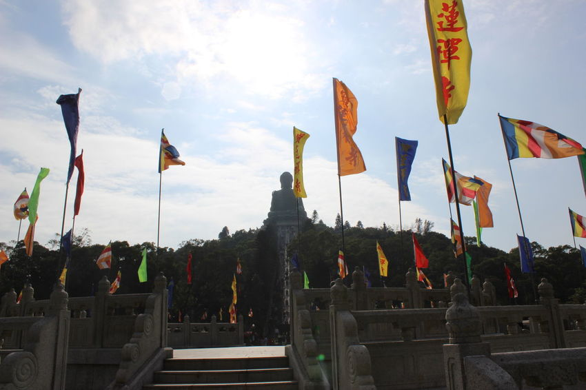 Sunlight No People Sky Outdoors Cultures City Day Statue Sculpture Travel Photography Travel Destinations HongKong Tian Tan Buddha (Giant Buddha) 天壇大佛 Low Angle View Cloud - Sky Flag In A Row