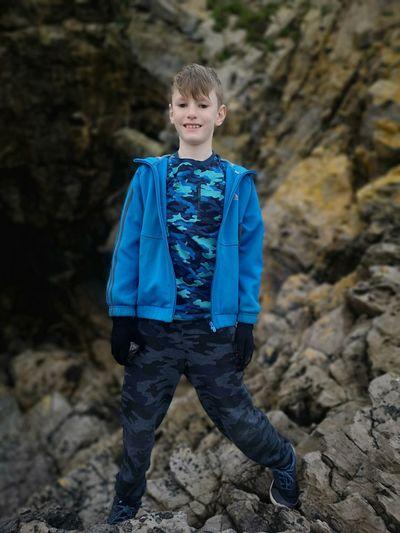 Portrait of boy standing on rocks
