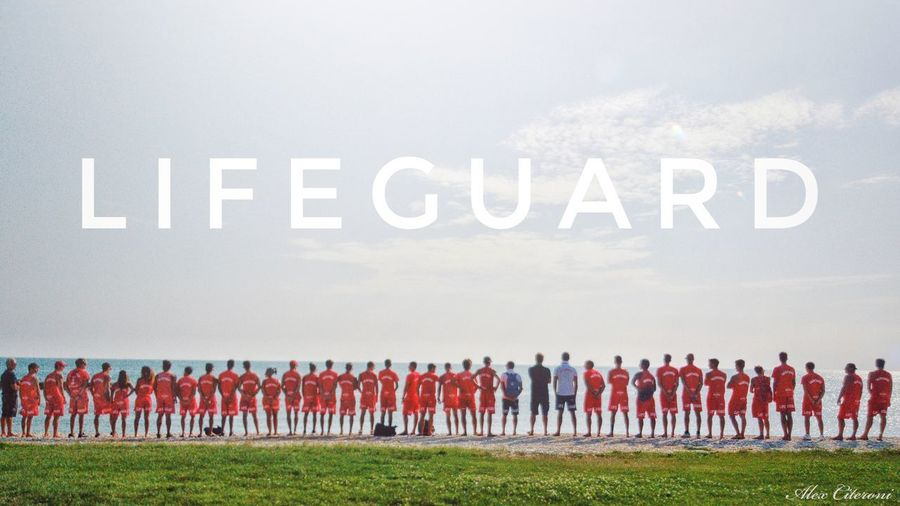 Group of people on field against the sky