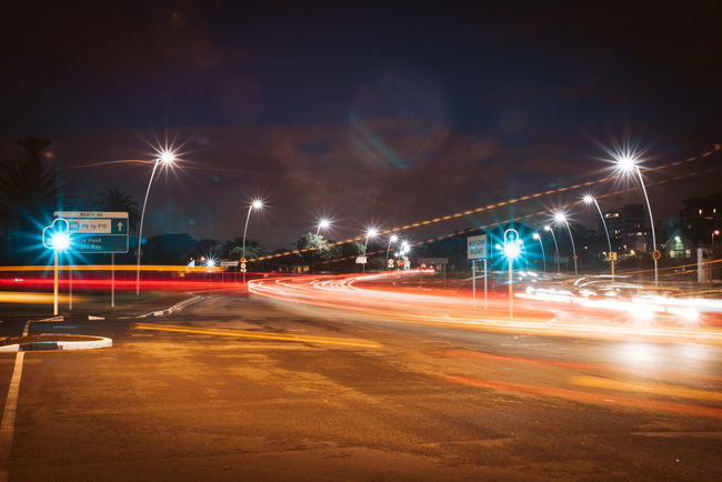 Architecture Blurred Motion City City Life Glowing Illuminated Lens Flare Light Light Trail Lighting Equipment Long Exposure Mode Of Transportation Motion Nature Night No People Outdoors Road Sky Speed Street Street Light Transportation