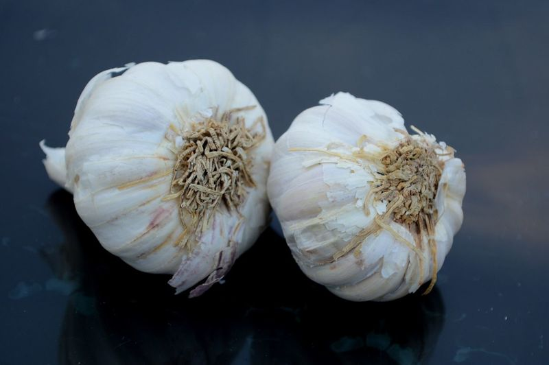 Close-Up Of Garlic Bulbs On Table