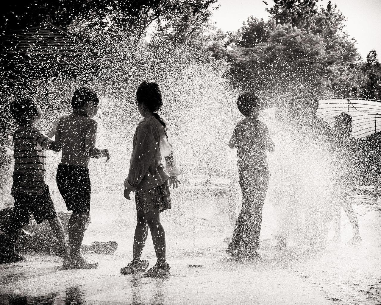 Children playing in splashing water