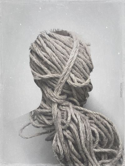 Close-up of rope against white background