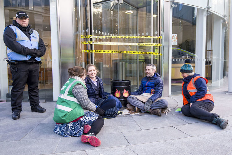 Group of people sitting outdoors