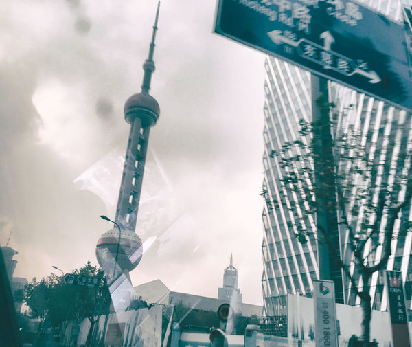 stangai on the move Low Angle View Reflection Shanghai Architecture Building Exterior Built Structure China Chinese City Day Edit Low Angle View Metropolis Move No People Outdoors Pearl Tower  Sky Skyscraper Streetphotography Tall Stories From The City