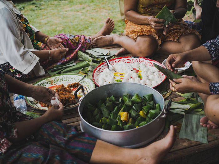 Group Of People Food And Drink Real People Food Women Bowl Men Lifestyles Adult Togetherness Human Body Part Human Hand Holding People Day Sitting Hand Midsection Vegetable Freshness Preparing Food