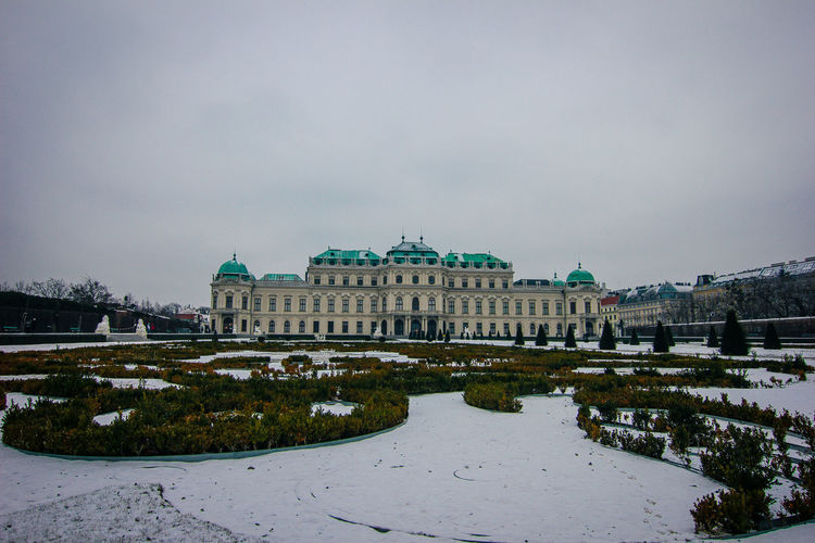 Vienna, Austria: 25th January 2019 / Belvedere castle in Wien during winter Architecture Summer Flowers Water Old City Art Sky Landscape Green Scenery Sightseeing Façade Vienna Tourist Museum Building Travel Tourism Fountain Day Town Castle Classic Wien Park Sculpture Famous Style Exterior Landmark Europe Austria Palace Attraction Monument Outdoor Historic Heritage Scenic Unesco European  Austrian Belvedere Historical Baroque Residence Capital Belvedere Palace - Vienna