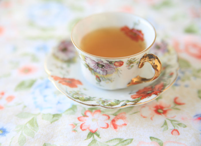 Tea in floral cup and saucer Afternoon Tea Close-up Cloth Cup And Saucer Cup Of Tea Day Decorative Drink Fabric Floral Floral Pattern Flower Designs Indoors  Liquid Natural Light No People Old-fashioned Ornate Porcelain  Pretty Refreshment Tea Cup Vintage Dishes