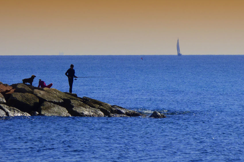 Beauty In Nature Clear Sky Fishermen Horizon Horizon Over Water Leisure Activity Men Nature Outdoors Real People Rock Rock - Object Scenics - Nature Sea Sky Water Waterfront