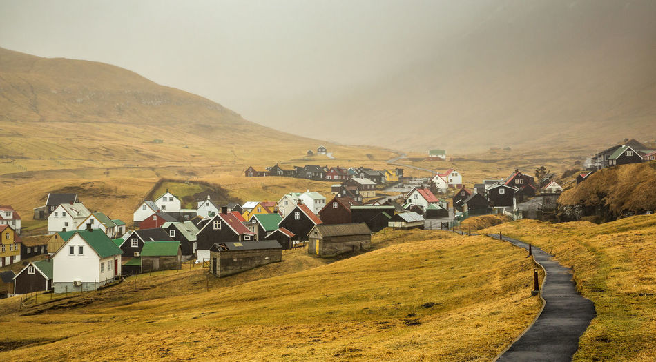 Architecture Mountain Building Exterior Building Built Structure House Landscape Environment Residential District Sky Land Scenics - Nature Village Day No People Nature Field Beauty In Nature Mountain Range Rural Scene Outdoors Faroe Islands Fog Misty Morning Pathway