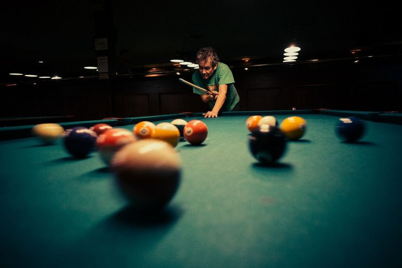 Man playing pool at night