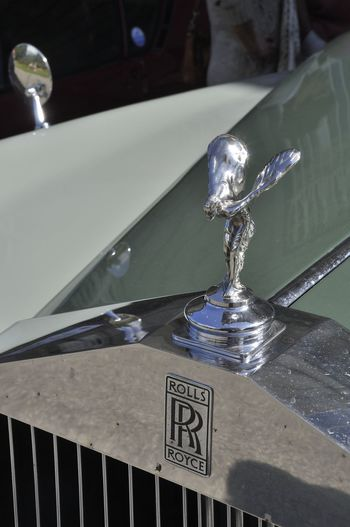 Roll Royce Statue Collector's Car Communication Focus On Foreground Glass - Material Household Equipment Luxury Metal Nature Prestige Reflection Silver Colored Steel Western Script