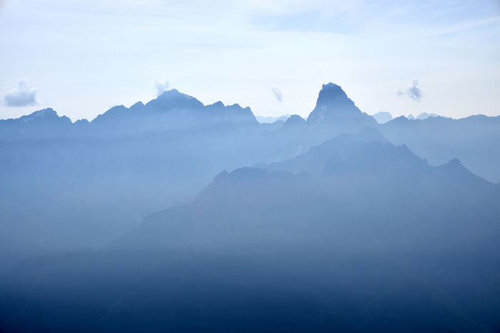 Mt. Duranno and Cima dei Preti, two of the most famous peaks of the Dolomiti Friulane range, from the summit of Mt. Sfornioi di Mezzo during a hazy day. Dolomites, Italy Silhouette Beauty In Nature Fog Hazy  Landscape Mountain Mountain Range Tranquil Scene Tranquility