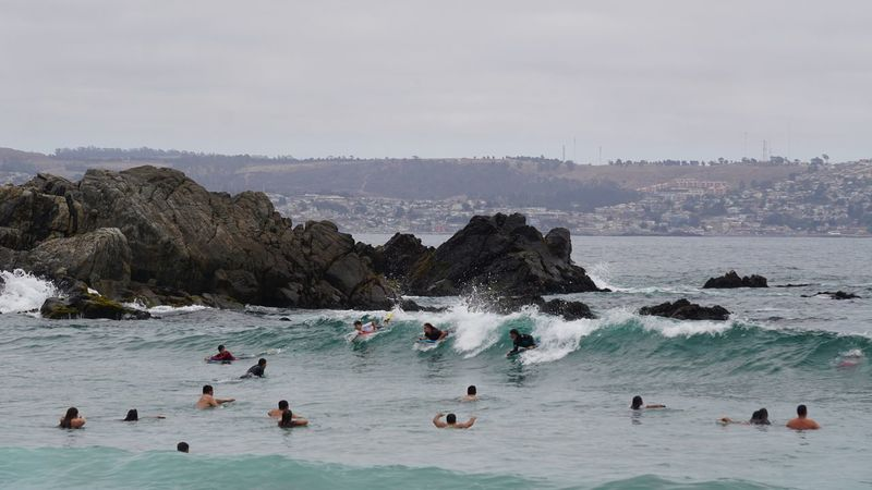 People bathing in the sea and practicing water sports Water Large Group Of People Beach Vacations Sea Leisure Activity Swimming Wave Sport Surfing Healthy Lifestyle Outdoors People Lifestyles Sky Day Nature Adult Beauty In Nature