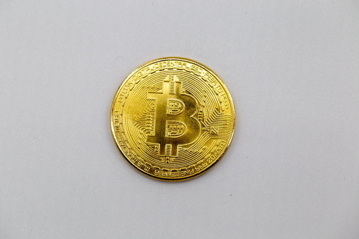 Bitcoin token isolated on white background. Cryptocurrency concept with copy space. BTC Banknotes Copy Space E-commerce Gold Isolated Virtual Bit  Bitcoin Bussiness Coin Concept Crypto Cryptocurrency Cypto Currency Euro Exchange Future Internet Minning Minning Bitcoin Money Pay Symbol White Background