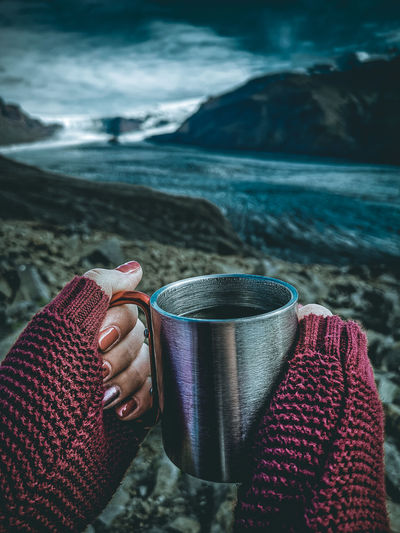 Tea time Iceland Teatime Cup Warm Clothing Sweater Girl Nails Glacier Ice Snowy Moody Sky Traveler Travel Photography Landscape Outdoors Day Mountain Rocks Blue Clouds Folk Adventure Skaftafellsjökull