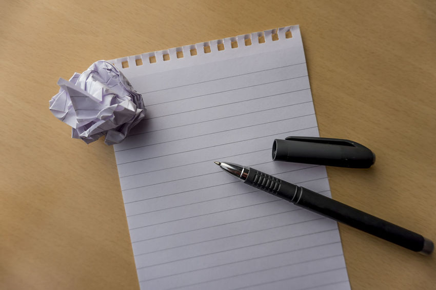 Writing Blank Close-up Crumpled Paper Crumpled Paper Ball Gel Pen High Angle View Indoors  No People Note Pad Note Paper Notebook Notepad And Pen Office Office Supplies Office Supply Page Paper Paperwork Pen Publication Table Writing Instrument