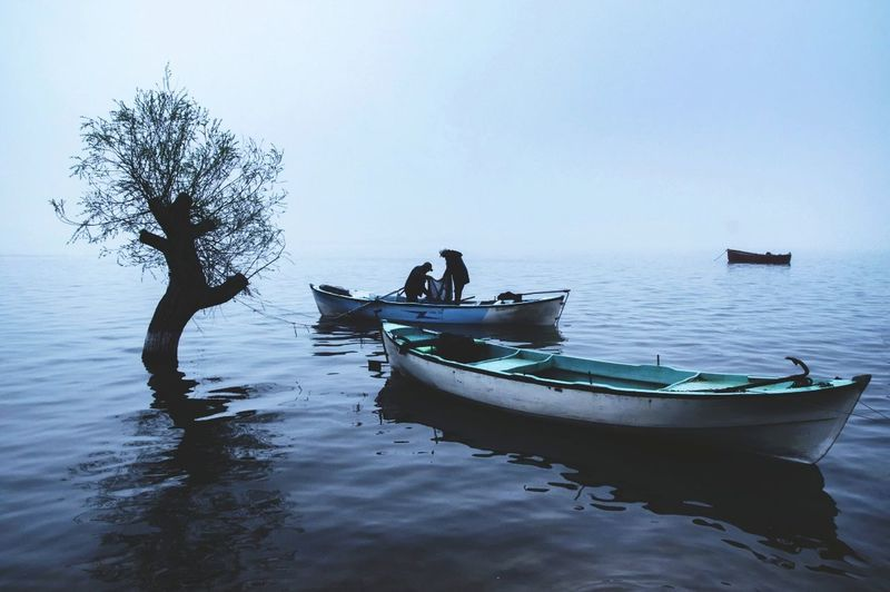 Fog Fisherman Multi Colored Nautical Vessel People Water Adult Nature Travel Destinations Landscape Sea Outdoors Tree Sky Focus On The Story The Traveler - 2018 EyeEm Awards My Best Photo The Traveler - 2019 EyeEm Awards The Photojournalist - 2019 EyeEm Awards The Street Photographer - 2019 EyeEm Awards