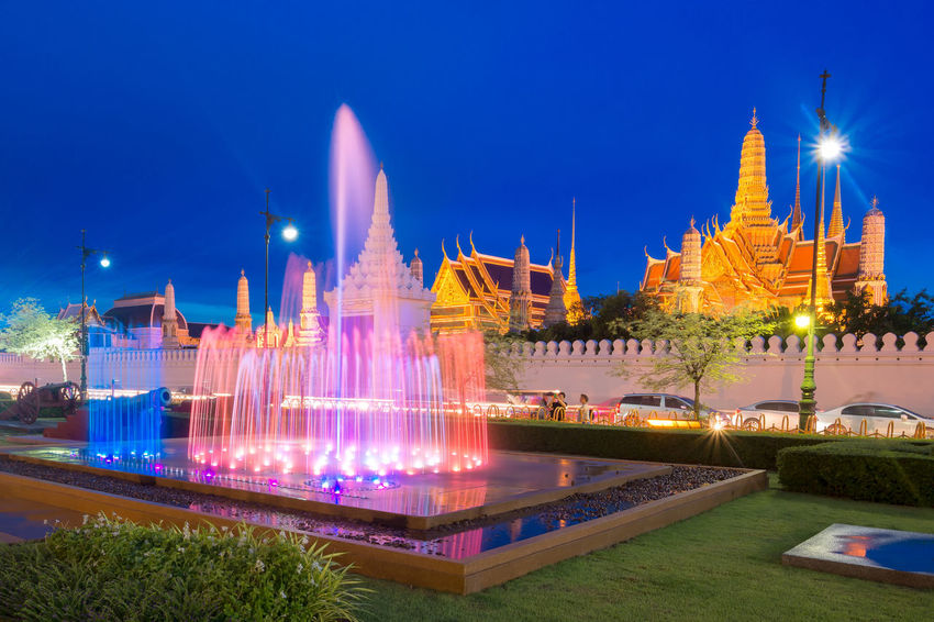Fountain dance show in front of Wat Phra Kaew, Temple of the Emerald Buddha in Bangkok, Thailand Bangkok Cityscape Colours Emerald Buddha Temple Fountain Gold Landmarks Sightseeing Thailand Travel Twilight Wat Phra Kaew Architecture Attraction Building Building Exterior Illuminated Landmark Landscape Night Outdoors Religion Temple Tourism Travel Destinations