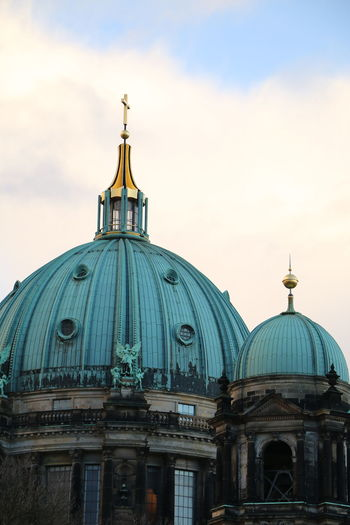 Berlin cathedral against cloudy sky