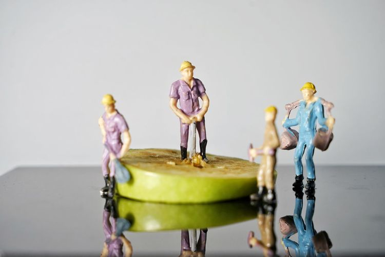 Male Likeness Human Representation Figurine  Indoors  Representation Studio Shot Table Female Likeness Group Of People Standing Creativity People Toy Men Cooperation Teamwork Food And Drink Bizarre Surreal