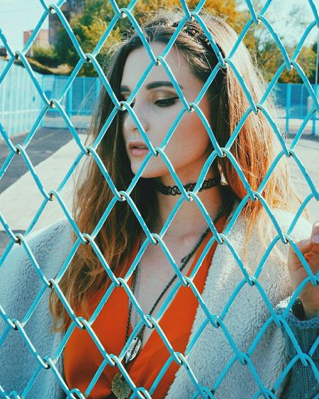 Chainlink Fence Only Women One Person Protection Outdoors Adult People Young Women Day Beautiful People Real People Beauty Sky Close-up