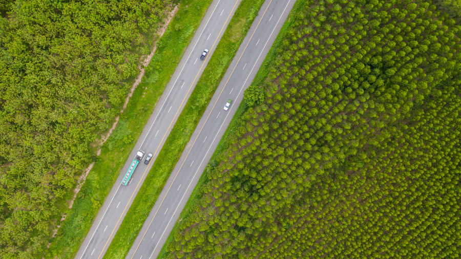 View Road Aerial Forest Top ASIA Through Green Above Curve Truck Thailand Rural Traffic Background Beautiful Nature Landscape Highway High Mountain Car Trip Woods Grass Natural Travel Tree Outdoor Environment Country Transportation Transport Asphalt Pass Journey Field Valley Lane Way Park Street Beauty Pattern Texture Plant Asian  Destination Grassland Freeway