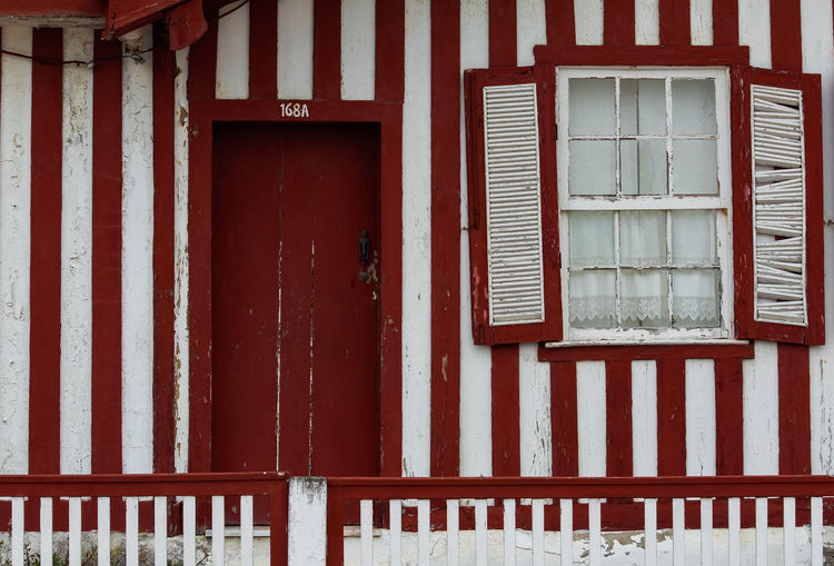 Typical red houses with stipes in costa nova - aveiro against sky