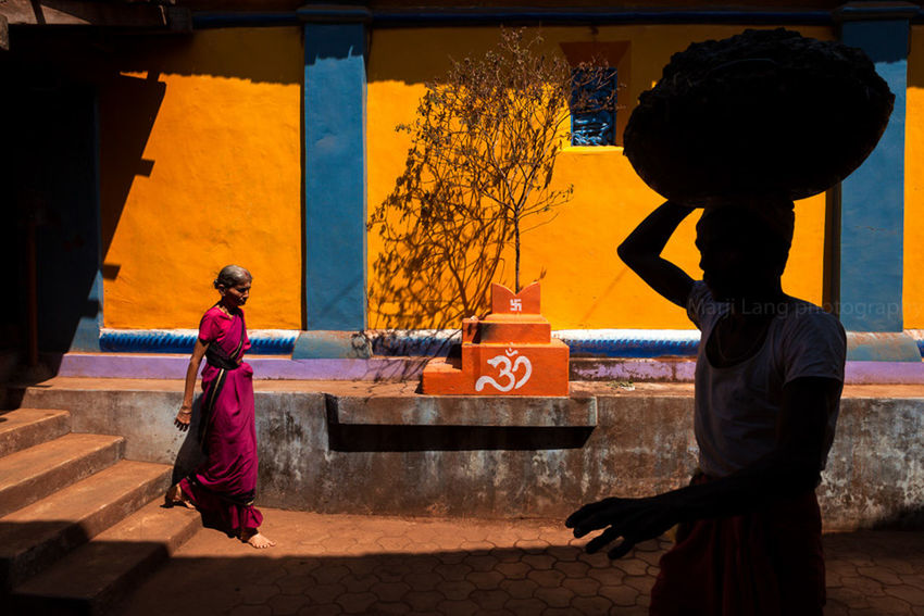 Colorful setting in south India. City Life Colorful Colors Composition Contrast Day Frame Gokarna India Indianstories Karnataka Light Light And Shadow Man Orange Color Outdoors People Silhouette Street Street Photography Streetphotography Temple Vivid Woman Yellow