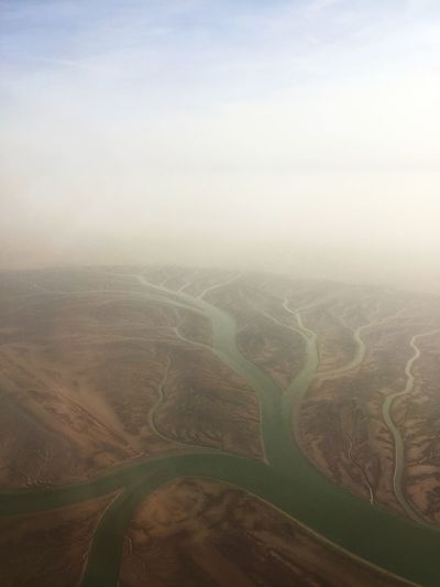 Aerial view. Naturally formed branches from a flowing river River Branch Fog Scenics - Nature Environment Landscape Tranquil Scene Tranquility Beauty In Nature Land Sky Field Nature Aerial View Rural Scene Agriculture No People Day Idyllic Outdoors