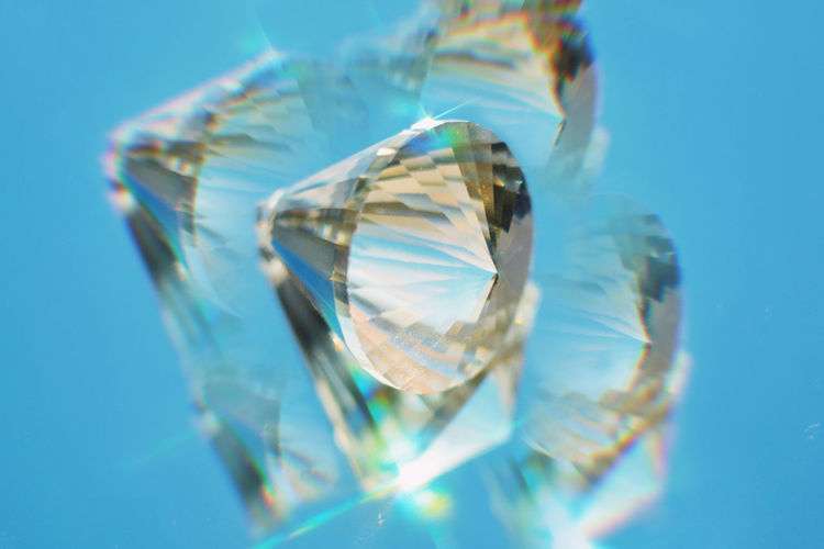 Close-up of glass against blue background