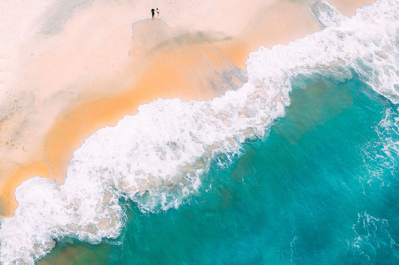 Water Sea Motion Nature Wave Day Beauty In Nature No People Outdoors Power Sport Splashing Power In Nature High Angle View Beach Aquatic Sport Land Orange Color Breaking Turquoise Colored