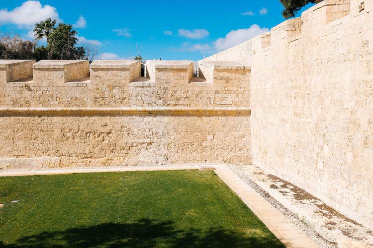 Wall Against Sky On Sunny Day
