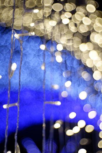 Close-up of illuminated lights hanging on ceiling