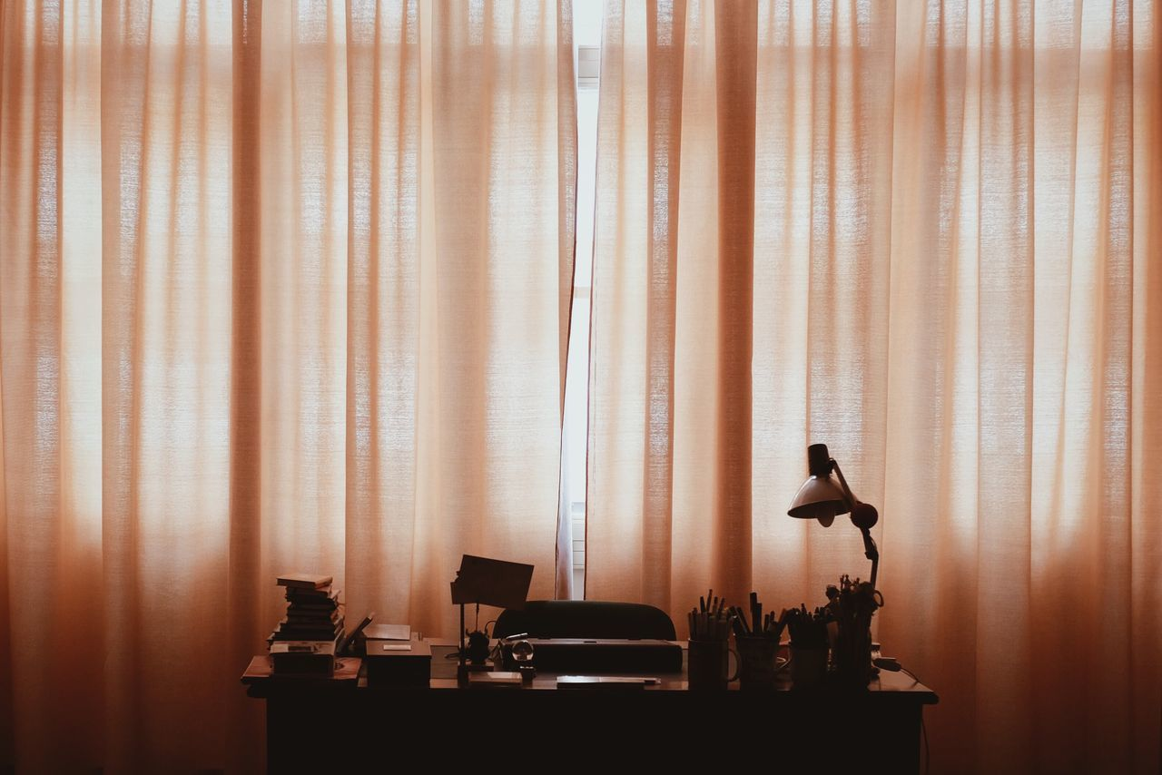 Table by curtain at home