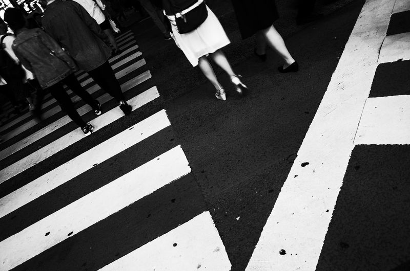 City Sign Low Section Road Marking Body Part High Angle View Marking Street Real People Crosswalk Road Lifestyles Crossing Human Leg Zebra Crossing Walking