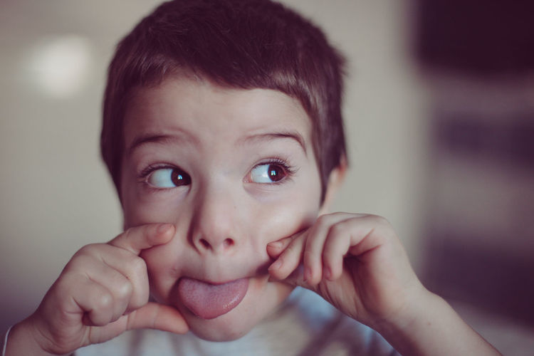 Close-Up Of Boy Sticking Out Tongue