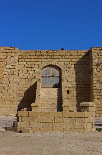 Architecture Blue Building Building Exterior Built Structure Clear Sky Day Dorset Gozo History Malta No People Old Ruin Outdoors Salt Pans Sand Color Sandy Simetry Sunset