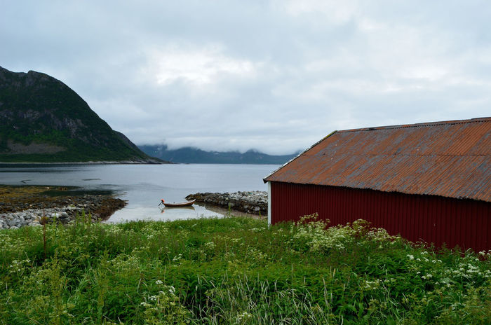 Beauty In Nature Boat Boathouse Building Cloud - Sky Cloudy Fjord Mountain Mountain Range Nature Non-urban Scene Ocean Outdoors Scenics Sea Sky Tranquil Scene Tranquility Water
