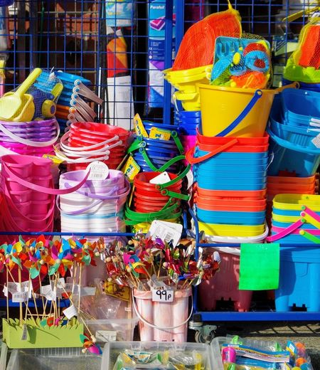 Buckets And Spades Colours Plastic Beach Gear Multi Coloured Shop Beach Shop No People Outdoors Cornwall Tourism Market Day Choice Large Group Of Objects