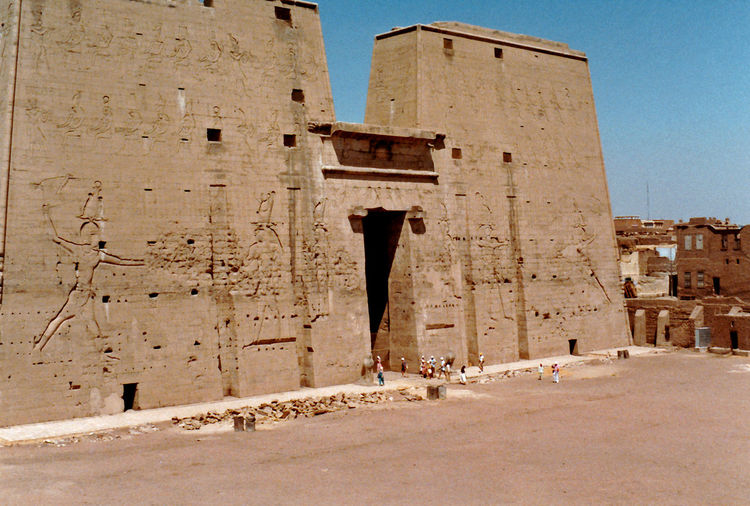 Temple of Horus - Edfu, Upper Egypt Architecture People Real People Men Sky Travel Tourism Day History Outdoors Ancient The Past Archaeology Clear Sky Tourist Attraction  Horus Travel Destinations Ancient Civilization Building Exterior Built Structure Old Ruin Falcon-Headed God Temple In A City
