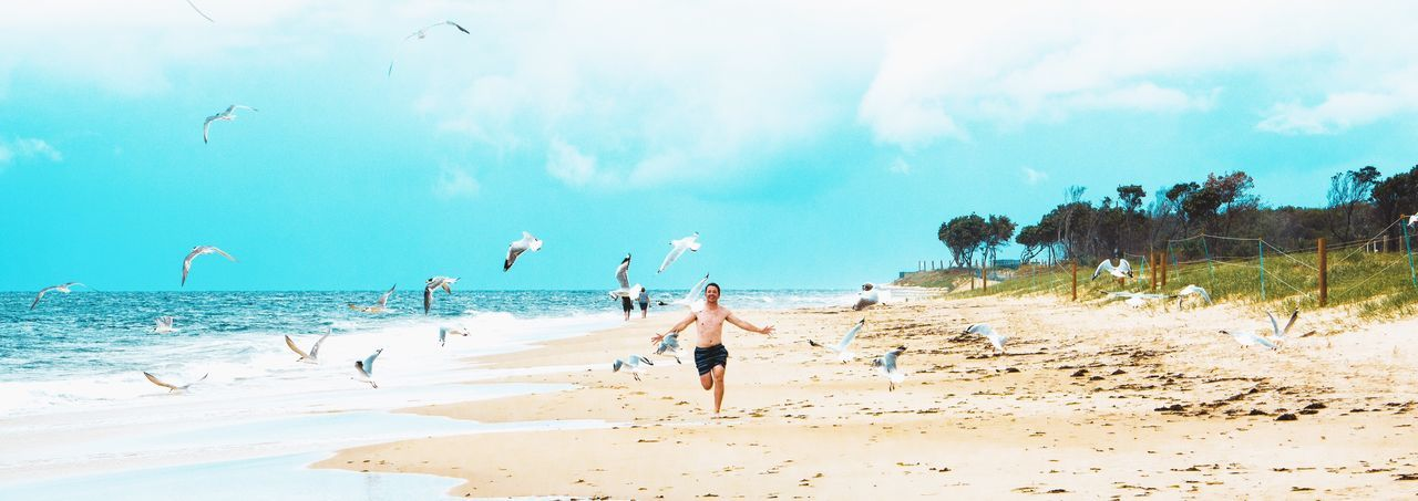 Beach Sea Sky Sand Shore Nature Water Vacations Lifestyles Outdoors Scenics Beauty In Nature One Person People Wave Tourism Mood